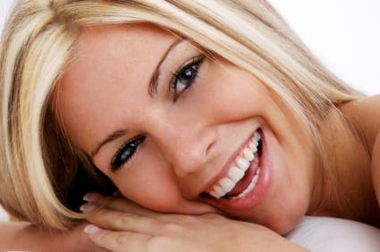 Blone woman smiling with perfect teeth
